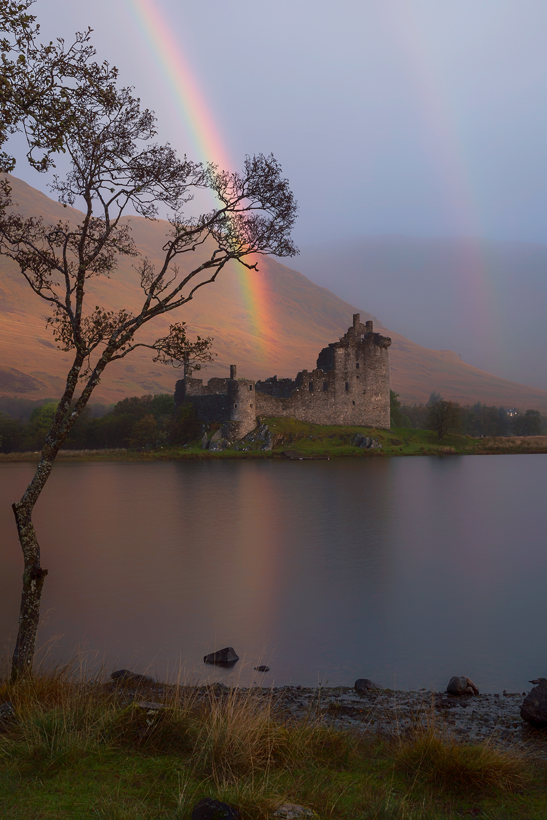 A double rainbow over Kilchurn Castle on the Scotland Photography Workshop